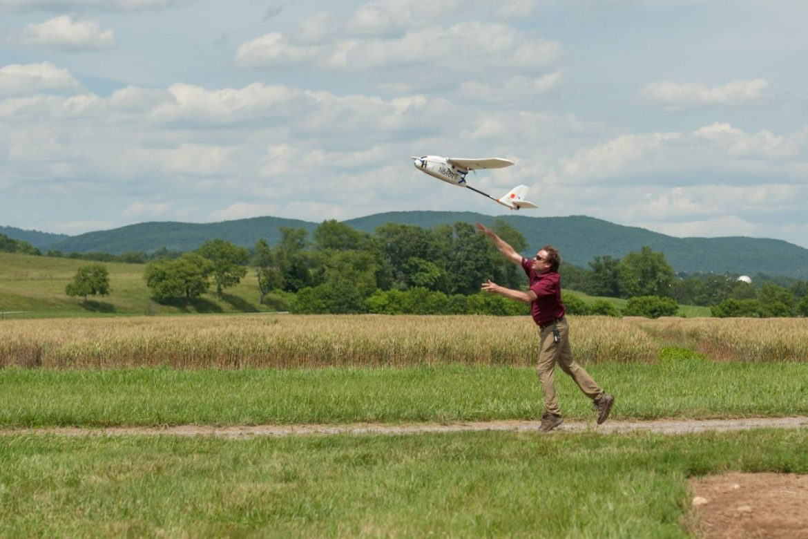 John Coggin, chief engineer for the Virginia Tech Mid-Atlantic Aviation Partnership, launches a fixed-wing unmanned aircraft which flew beyond its operator's visual line of sight on a simulated mapping mission. Coordinating the flights of different types of aircraft performing different tasks will be necessary for managing real-world unmanned aircraft traffic.